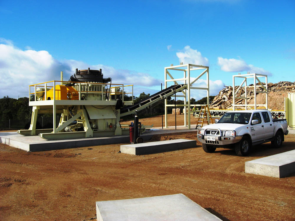 A side view picture of a concrete recycling plant